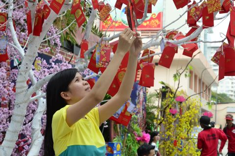 A Vietnamese woman prepares for Tet holiday in Vietnam